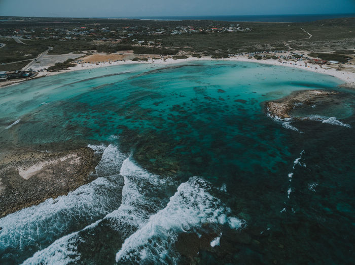 Aerial shot of Baby Beach in Aruba. Aruba Aerial View Beach Beachphotography Beauty In Nature Caribbean Day High Angle View Idyllic Land Motion Nature No People Non-urban Scene Outdoors Power In Nature Rock Rock - Object Scenics - Nature Sea Solid Tranquil Scene Tranquility Turquoise Colored Water