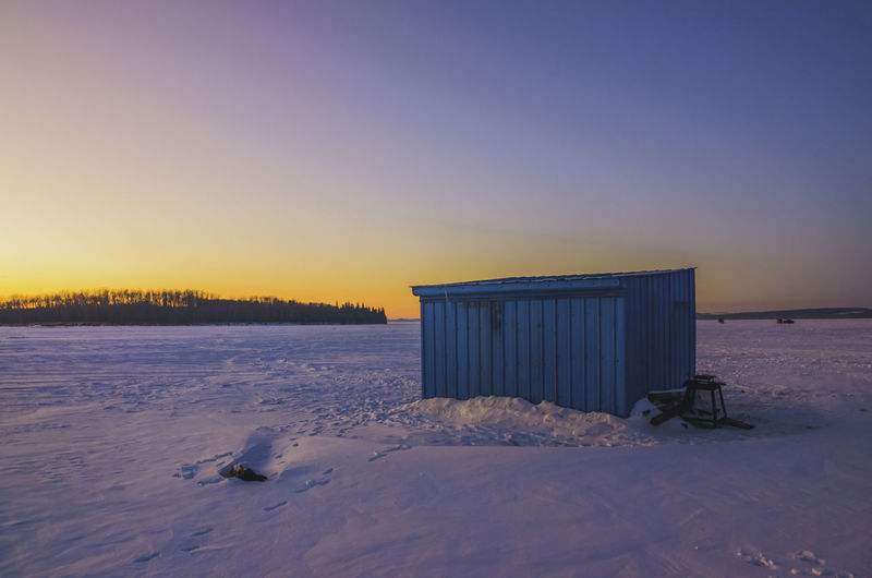 Beauty In Nature Clear Sky Cold Temperature Ice Fishing Ice Fishing Huts Ice Shack No People Scenics Sky Sunset Winter