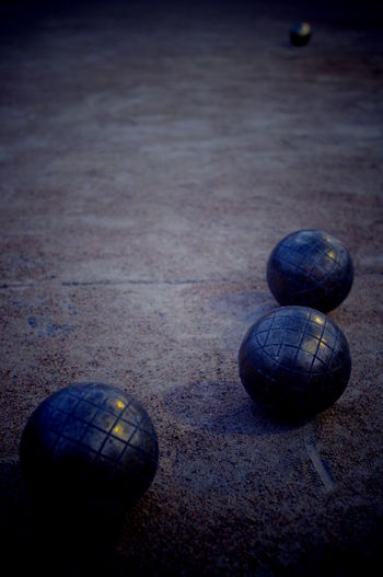 Ball Boccia Boule Composition Fun Globe Leisure Activity Lifestyles Metal Mystery Order Outdoors Playing Rough Shiny Sphere Spheres Sport