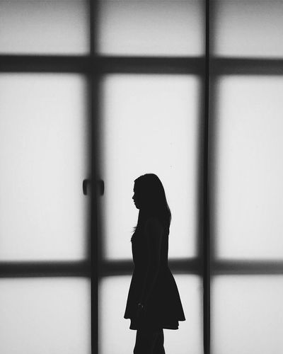 Close-up of woman standing in the dark