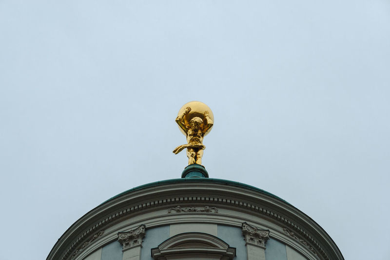 Architecture Building Exterior Built Structure Day Gold Colored Human Representation Low Angle View No People Outdoors Sculpture Sky Spirituality Statue