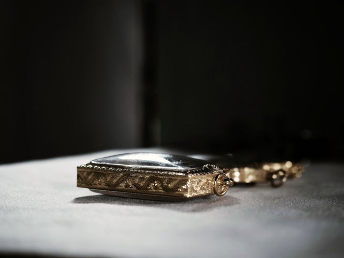 Close-up of jewelry on table
