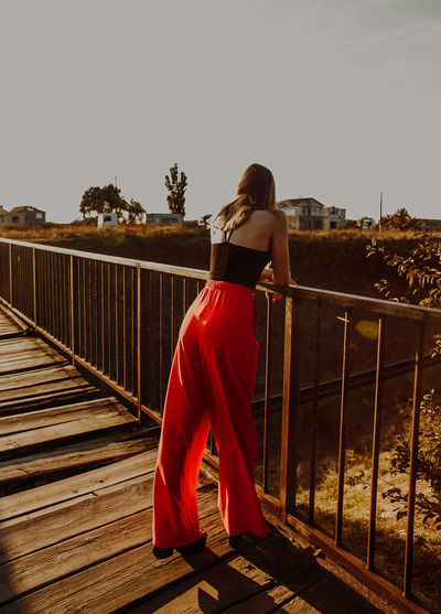 ❤️ Red Pants The Week On EyeEm Bridge - Man Made Structure Clear Sky Footbridge Leisure Activity Lifestyles Nature One Person Railing Real People Rear View Standing Women Young Women