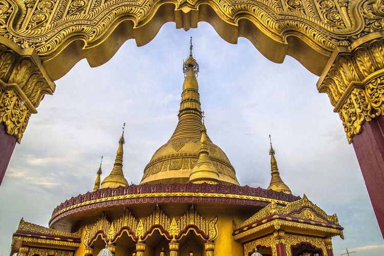 Low angle view of gold colored buddhist temple