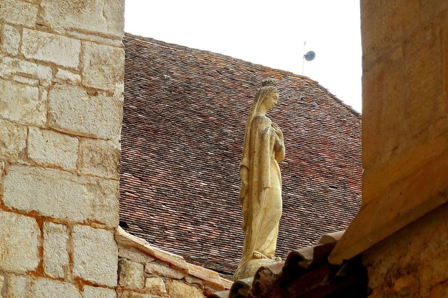 Statue amongst the rooftops, Rocamador, Lot, France. Statue Roof Rooftop Rooftop Scenery Architecture Place Of Worship Outdoors Day Sky No People Rocamadour France From My Point Of View Check This Out France Photos