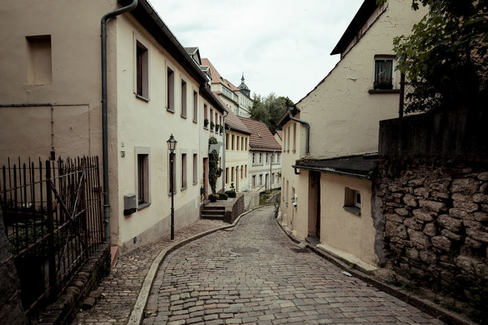Sweet small streets Cobblestone Streets Daytime Lantern Road Urban Geometry Architecture Building Exterior Built Structure Cobblestone Cobblestones Day Daylight No People Outdoors Sky Street Street Photography Streetphotography The Way Forward Town Urban
