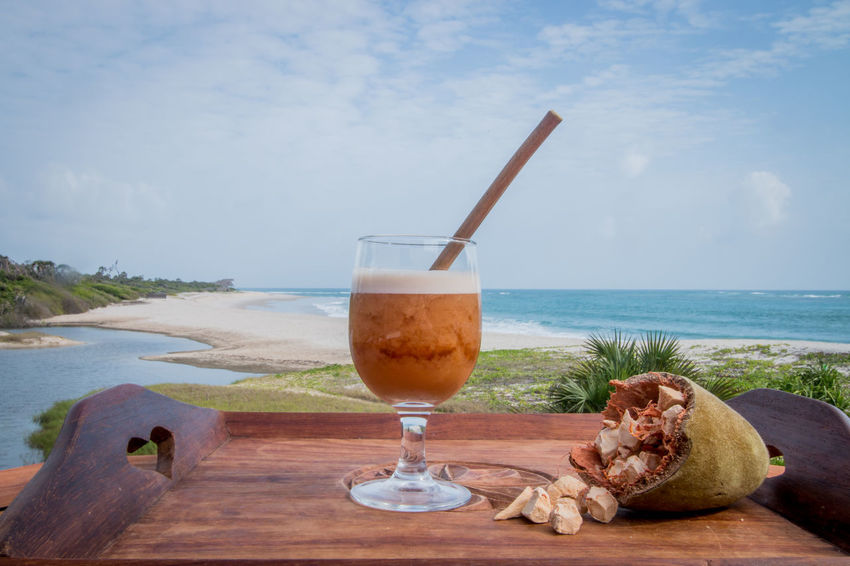 Cocktails by the beach with eco friendly Bamboo straws! Cocktail Cocktail Time Africa Bamboo Straw Baobab Baobab Fruit Beach Cocktails Day Drink Drinking Glass Drinking Straw Eco Friendly Food And Drink Freshness Goodlife Horizon Over Water Nature No People Outdoors Paradise Refreshment Sea Sky Water