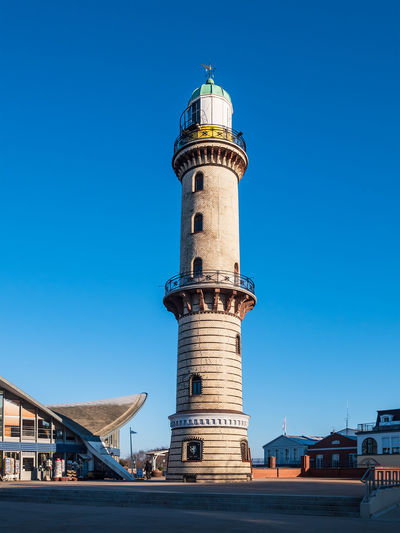 View to the Lighthouse in Warnemuende, Germany Architecture Built Structure Building Exterior Building Clear Sky Blue Travel Tower Travel Destinations Tourism No People Day Outdoors Lighthouse Direction Warnemuende Warnemünde Rostock Mecklenburg-Vorpommern Germany Landmark Travel Vacation View