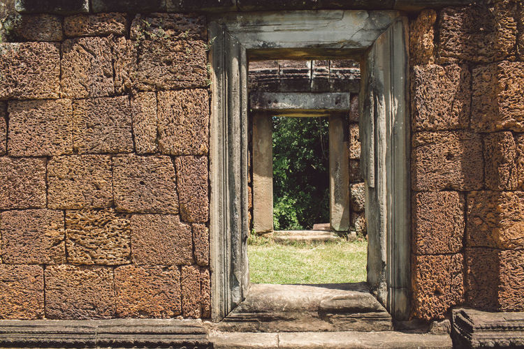 Siem Reap Cambodia Angkor Architecture Built Structure Building Day Entrance No People History Old Building Exterior The Past Door Outdoors Abandoned Nature Wall - Building Feature Architectural Column Wall Sunlight House Weathered Stone Wall Ancient Civilization Ruined