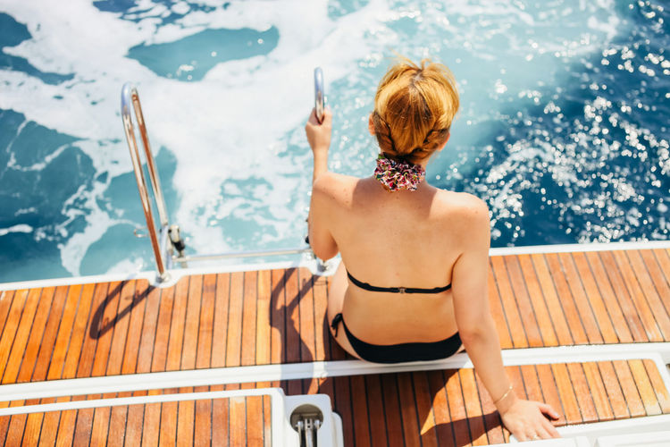woman swimming and yachting in summer. Luxurylifestyle  Swimming Vacations Beautiful Woman Blond Hair Leisure Leisure Activity Lifestyles Luxury Nautical Vessel One Person Outdoors People Real People Sail Sea Sitting Swim Vacation Vacations Water Yacht Yachting Young Women