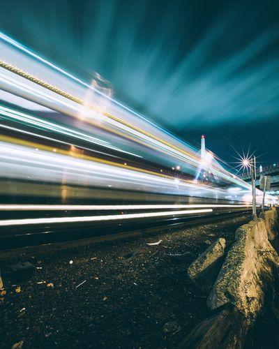 Light trails on railroad tracks at night