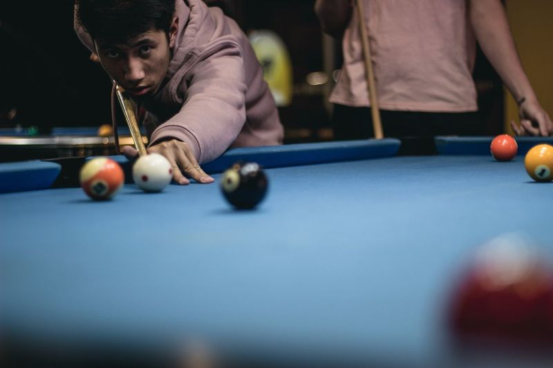 Portrait of boy playing pool