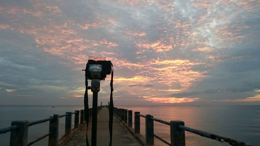 Behind the scene Beauty In Nature Scenics Nature Water Sky Outdoors Travel Destinations Beach Sea Landscape That's Me Sunrise Enjoying Life Jetty Perspective Behindthescenes No People Lake Sunset Tranquility Day