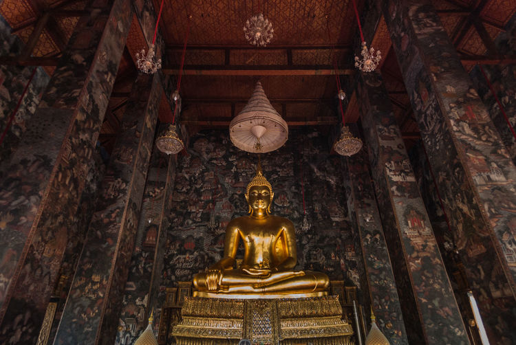 Gloden Bhudda statue in Wat suthat Bangkok Thailand Wat Suthat Architecture Day Gold Gold Colored Indoors  Low Angle View No People Place Of Worship Religion Sculpture Spirituality Statue