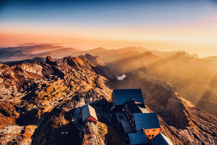High angle view of mountain range at sunset