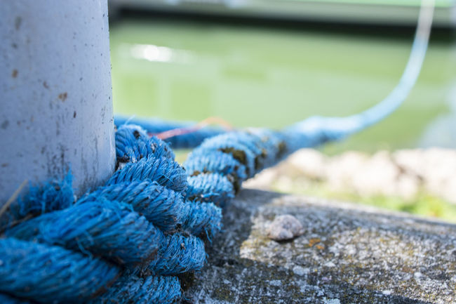 Blue Close-up Connection Day Durability Focus On Foreground Harbor Metal Nature No People Outdoors Pattern River Rope Sea Selective Focus Strength Textured  Tied Knot Tied Up Transportation Water Wooden Post
