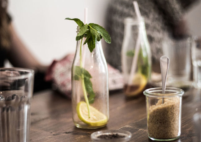 Food Stories Brown Sugar Lemonade Cafe Table Cafe Time Close-up Day Drink Drinking Glass Focus On Foreground Freshness Indoors  Lemon Mint Leaves No People Table Water