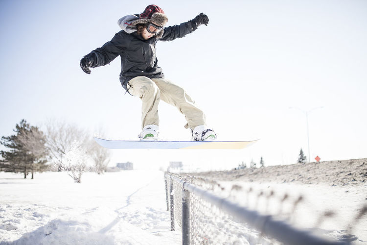 Full length of man jumping in snow