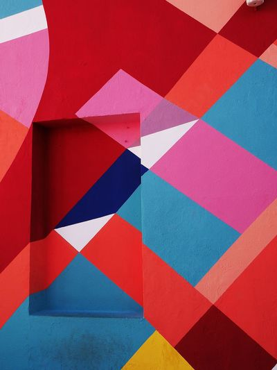 Multi Colored Full Frame Pattern Backgrounds Red Geometric Shape Shape No People Design Blue Art And Craft Triangle Shape Close-up Wall - Building Feature Indoors  High Angle View Creativity Paper Day Built Structure Angle