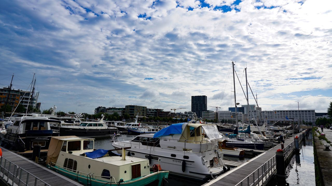 cloud - sky, architecture, sky, built structure, nautical vessel, moored, building exterior, harbor, no people, day, transportation, outdoors, mode of transport, water, city, nature, cityscape