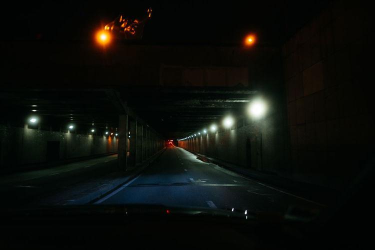 Illuminated street lights in tunnel