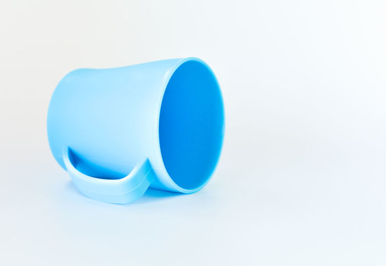 Close-up of blue paint against white background