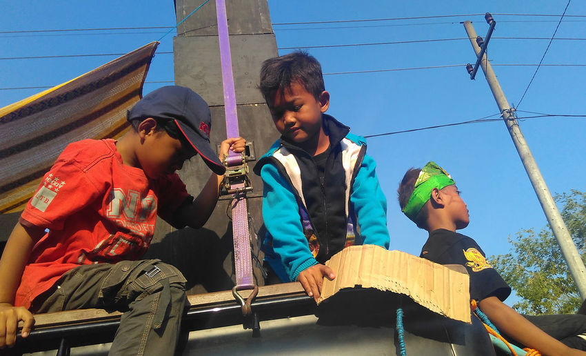 Expression Bocah Children East Java East Java-Indonesia INDONESIA Java Natural Boys Child Childhood Day Elementary Age Expression Java Indonesia Javanese Leisure Activity Lifestyles Low Angle View Natural Expressions Nganjuk Outdoors Playing Real People Sitting Sky Togetherness