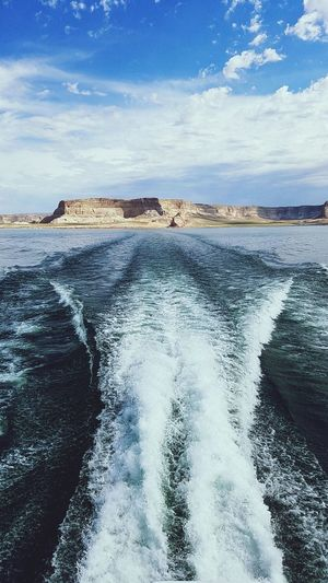 Lake Boating Boat Trip Blue Nature Landscape Travel Destinations Outdoors No People Beauty In Nature Horizon Over Water Vacations Water Wave Sky Ripples Summertime