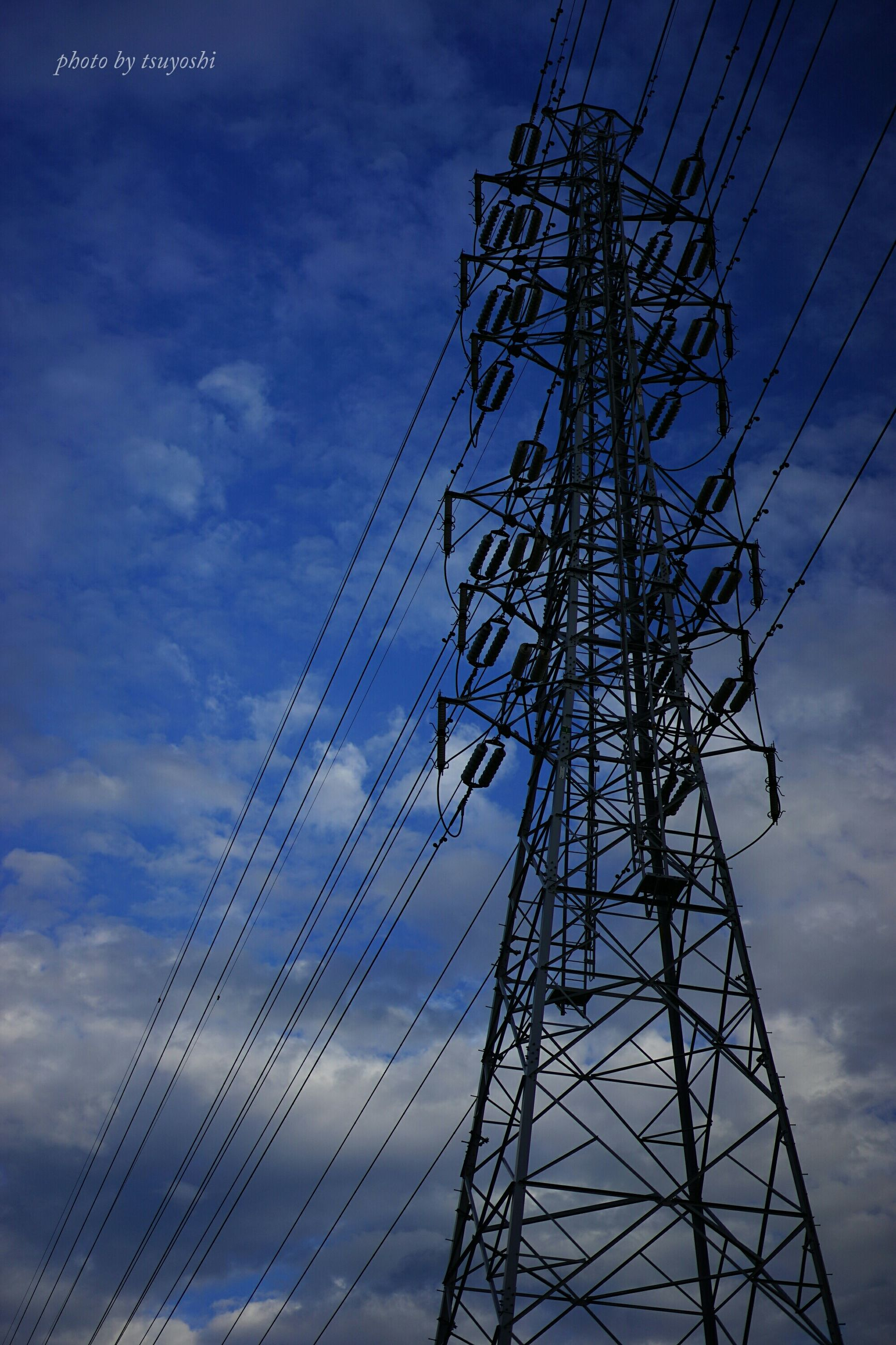 low angle view, electricity pylon, power line, electricity, power supply, connection, fuel and power generation, sky, technology, silhouette, cable, cloud - sky, complexity, blue, tall - high, dusk, cloud, outdoors, cloudy, no people