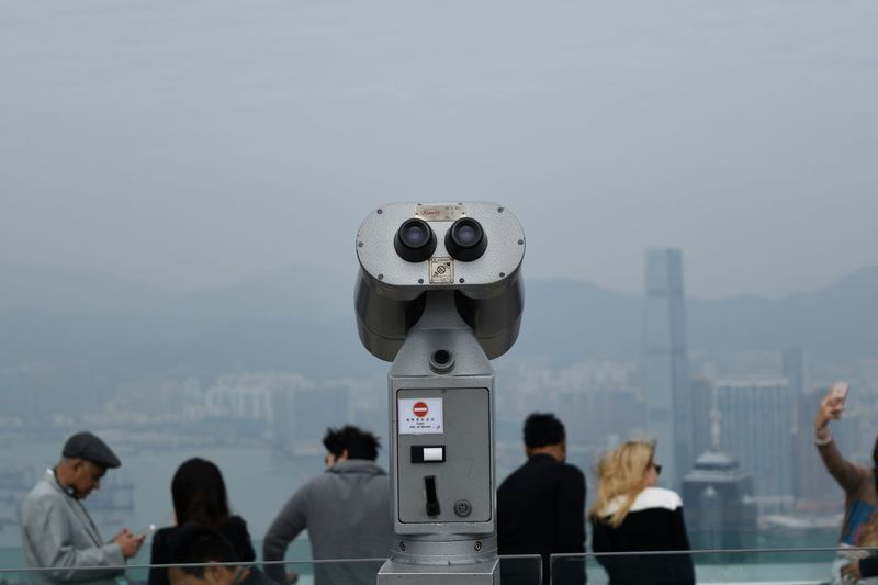 Coin-Operated Binoculars Against People In City