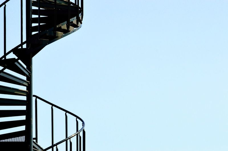 Low Angle View Of Spiral Staircase Against Clear Sky