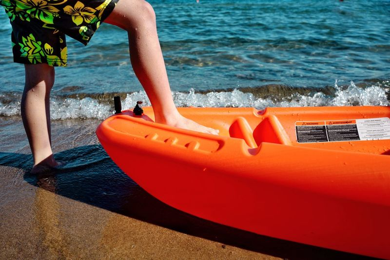 Vacation 2018 In One Photograph Moments Of Happiness Boy Child Childhood Memories Childhood Waterdrops Funtimes Water Fun Waterfront Playing Canoe Kayak Boat Water Beach Human Leg Low Section Nautical Vessel Human Body Part Sport Nature Land Lifestyles Aquatic Sport Leisure Activity Outdoors Human Limb Orange Color