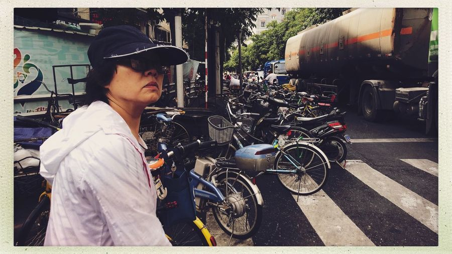Streetphotography Transportation Transfer Print One Person Mode Of Transportation Auto Post Production Filter Real People City Clothing Leisure Activity Hat Lifestyles Young Men Cap Architecture Day Glasses Land Vehicle Street Outdoors