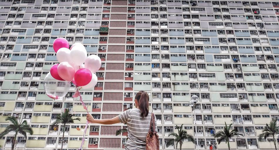 "The Architect - 2017 EyeEm Awards ""Rainbow Building"" Balloon One Person One Woman Only Only Women People Women Adults Only Adult City Life Lifestyles Day Smiling City Cheerful Happiness One Young Woman Only Helium Balloon Real People Young Adult Outdoors"
