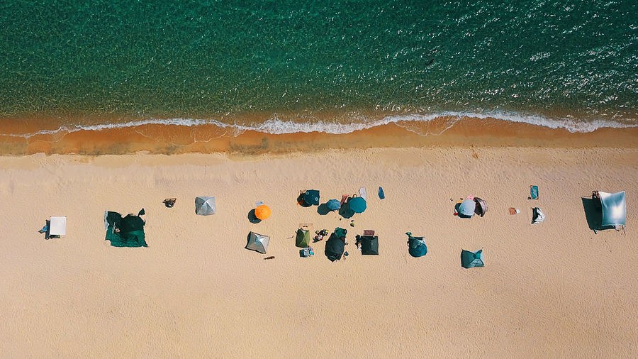 Beach Beauty In Nature Day High Angle View Holiday In A Row Land Multi Colored Nature No People Outdoors Sand Scenics - Nature Sea Sunlight Tent Trip Vacations Water