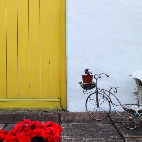 Sculpture On Tricycle Design By Door