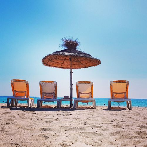 EyeEm Selects Beach Sand Summer Sea Vacations Outdoor Chair Chair Sky Retro Styled Protection Outdoors Sun Tranquility Water Relaxation Travel Destinations Djerba, Tunisia Djerba  Island Deck Chairs Beach Umbrella Beach Day No People Beach Holiday Summer Road Tripping