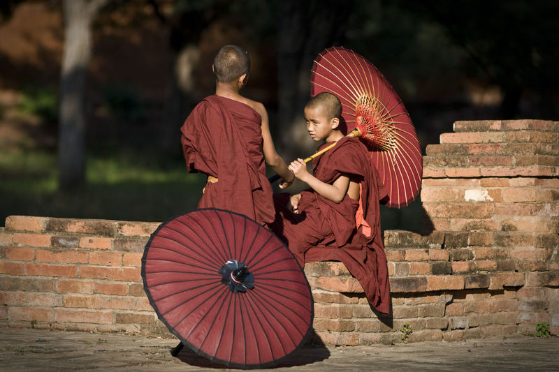 Buddha Buddha Buddhism Buddhist Buddhist Monks Buddhist Temple Burma Check This Out Close-up Creativity Cultures Day First Eyeem Photo Hanging Out Hello World Monk  Monks Myanmar Outdoors Picoftheday Red Temple - Building Traveling Umbrella Young Monk