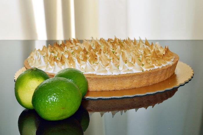 High Angle View Lemon Pie with meringue on top Dessert Freshness Lemon Pie Reflection Delicious Food Fresh Gourmet Indulgence Foodphotography Lemon Round Shape Sweets Tabletop