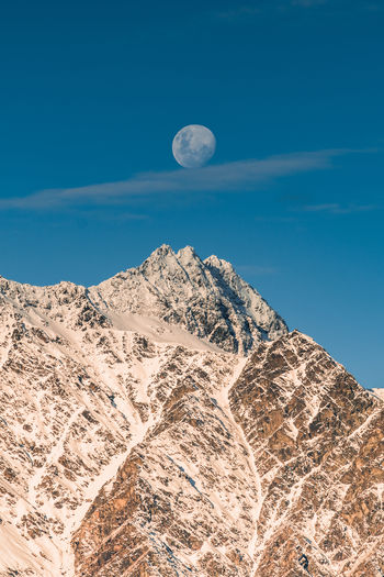 Moonrise over Queenstown, NZ Sky Sky And Clouds Photo Photography Photooftheday Nature Nature_collection New Zealand Queenstown Mountain Mountain Range NZ Astronomy Hot Air Balloon Space Flying Half Moon Moon Space Travel Vehicle Desert Crescent Mid-air Full Moon Moonlight