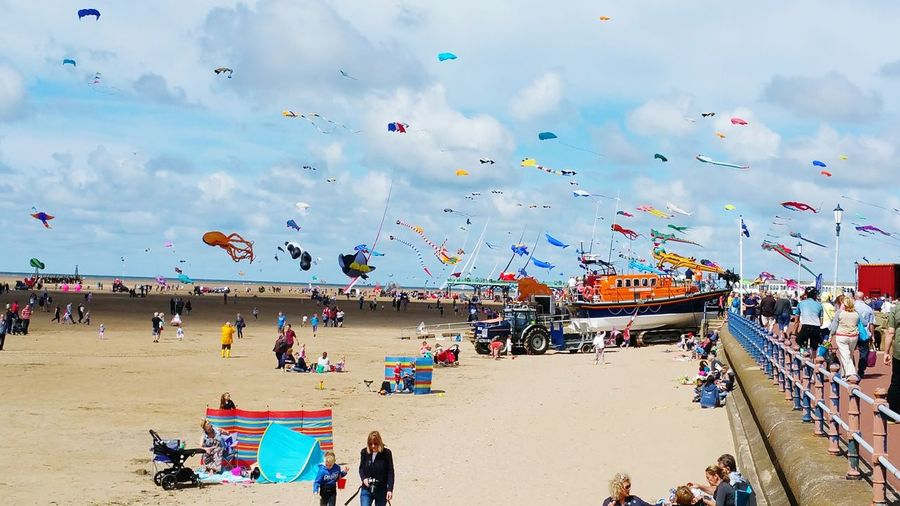 Crowd with kites at beach