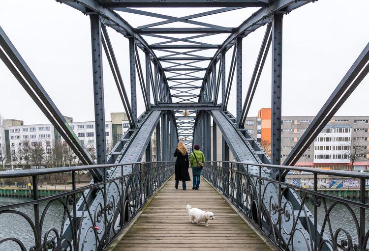 People walking on arch bridge
