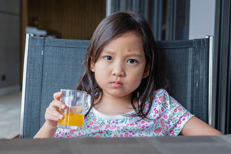 Portrait Of Girl Drinking Juice