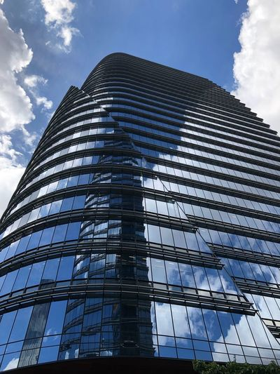 Deep blue The Street Photographer - 2019 EyeEm Awards Low Angle View Sky Cloud - Sky Built Structure Architecture Building Exterior The Minimalist - 2019 EyeEm Awards Tall - High Modern City Building Office Building Exterior Office Tower Skyscraper Glass - Material Day Outdoors No People
