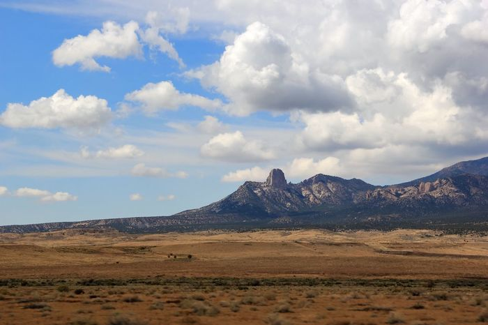 Landscape Mountain Tranquil Scene Tranquility Scenics Physical Geography Sky Cloud Non-urban Scene Geology Mountain Range Remote Beauty In Nature Extreme Terrain Nature Arid Climate Cloud - Sky Solitude Barren Tourism USAtrip Wide Open Spaces Miles Away