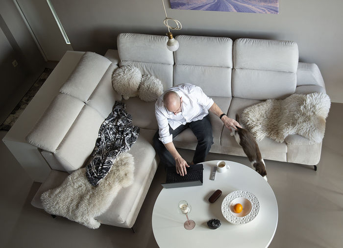 High angle view of man relaxing on table at home