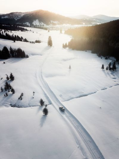 Winter Cold Temperature Beauty In Nature Snow Tranquility Tranquil Scene Mountain Scenics - Nature Tree Plant Nature Sky Non-urban Scene Water No People White Color Covering Environment Day Outdoors Snowcapped Mountain Car Road Aerial View Dronephotography
