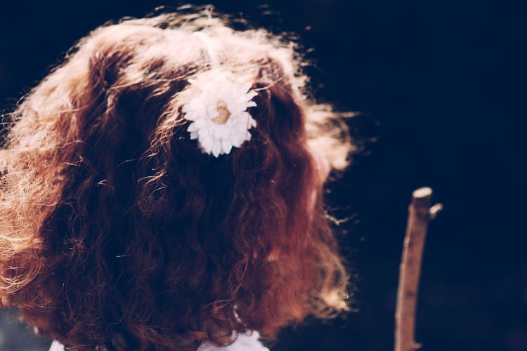 Rear view of woman with flower in hair