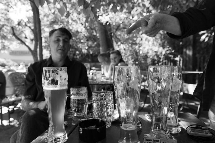 Berlin Prater S/w-Fotografie Trzoska Alcohol Biergarten Drink Drinking Glass Focus On Foreground Food And Drink Glass Gregor Hand Lifestyles Men People Prenzlauer Berg Real People S/w Sitting Table Zeigefinger Gottes