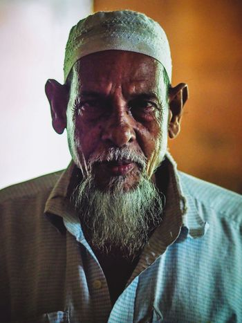 Portrait Of A Man  Portraiture Portrait Photography Iman Muslim Travel Destinations Street Photography Streetphotography Bangladesh 🇧🇩 Bangladesh Portrait Headshot Real People One Person Indoors  Front View Close-up Males  Men Lifestyles Beard Looking At Camera Facial Hair Mature Men Leisure Activity Mid Adult Men Adult Casual Clothing Human Face Mustache The Portraitist - 2018 EyeEm Awards EyeEmNewHere The Street Photographer - 2018 EyeEm Awards